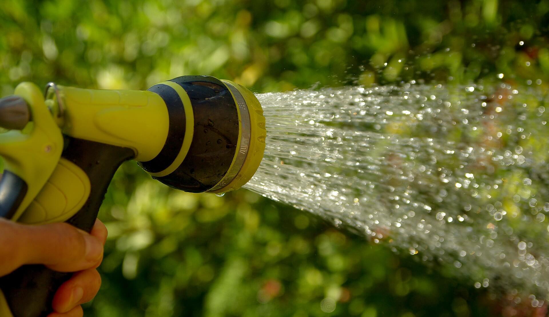 Hose with sprinkler system